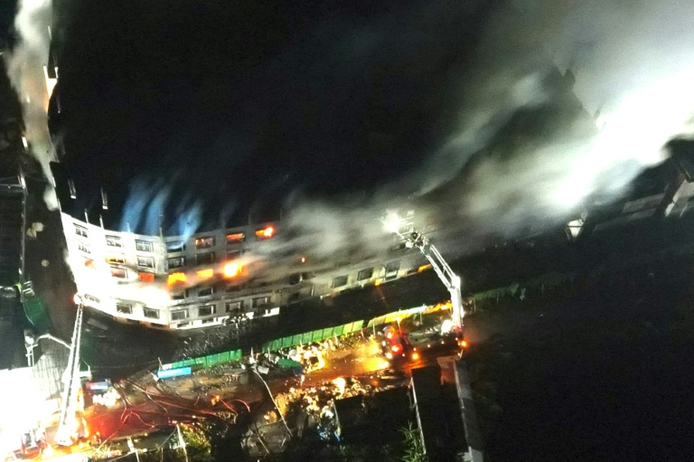An aerial photograph of the fire at a Bangladesh factory in which at least 52 people died.
