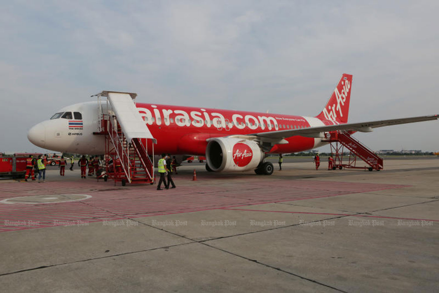 Thai AirAsia is flying this weekend but will halt all domestic services from July 12-31 in an effort to reduce travel and the risk of Civid spreading. (File photo)