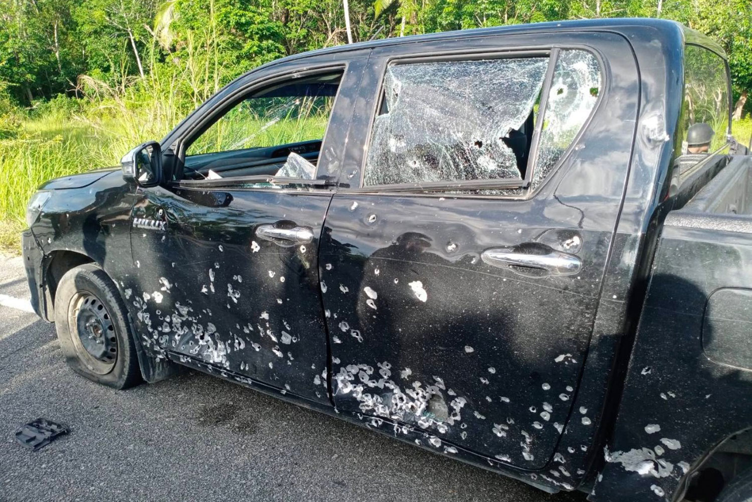 A police pickup truck was damaged in a bomb and shooting attack in Sai Bui district of Pattani on Saturday afternoon. Five officers on board were wounded. (Photo: Abdullah Benjakat)