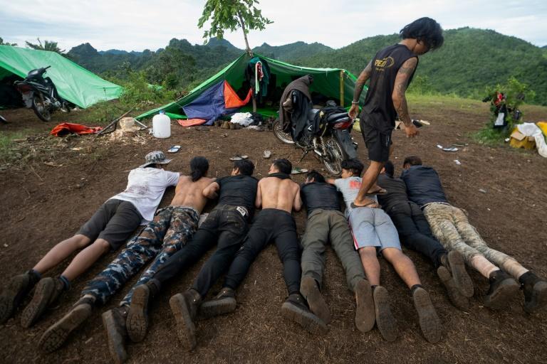 Members of Myanmar's Karenni People Defense Force take part in military training at their camp near Demoso in Kayah state.