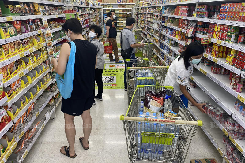 People flock to a supermarket on Friday before a curfew will come into force on Monday. (Photo: Nutthawat Wicheanbut)