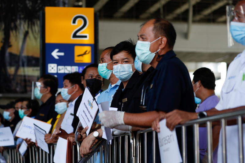Hotel drivers wait for passengers at Phuket airport, as the province reopens to overseas tourists on July 1. (Photo: Reuters)