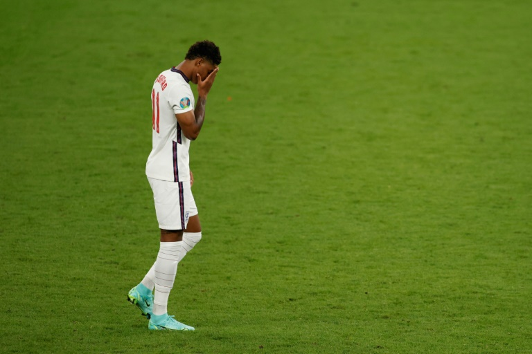 England's forward Marcus Rashford reacts after he fails to score in the penalty shootout during the Euro 2020 final football match between Italy and England at the Wembley Stadium in London on Sunday.