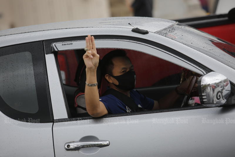 A driver flashes a symbol against the government on July 10, 2021. Protesters will rally again on Sunday. (Photo: Wichan Charoenkiatpakul)