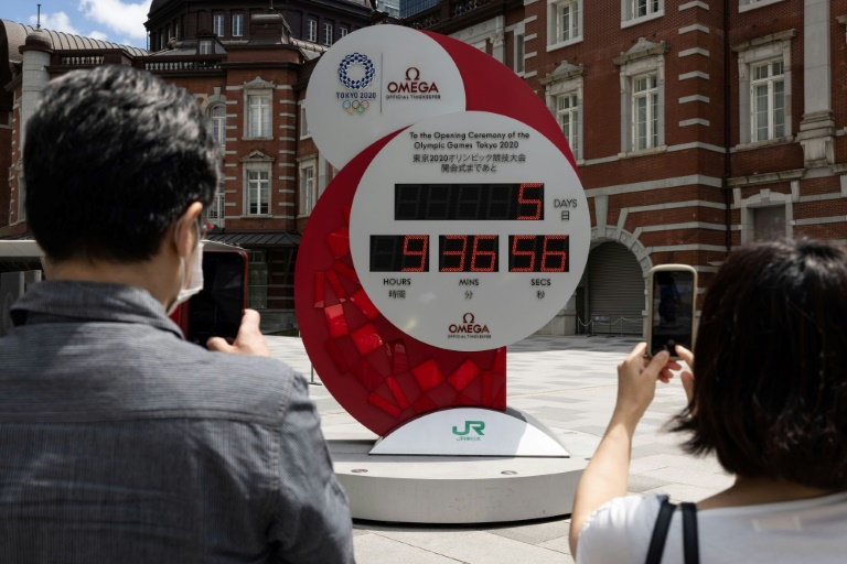 The Tokyo Olympic countdown clock shows five days to go before the opening ceremony on July 23.