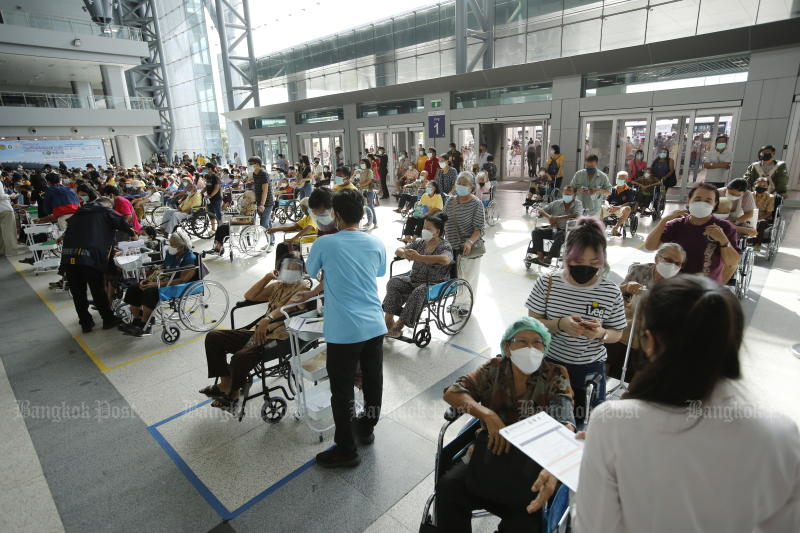 Senior citizens wait for their turn to be vaccinated at Bang Sue Grand Station on Sunday. (Photo: Wichan Charoenkiatpakul)