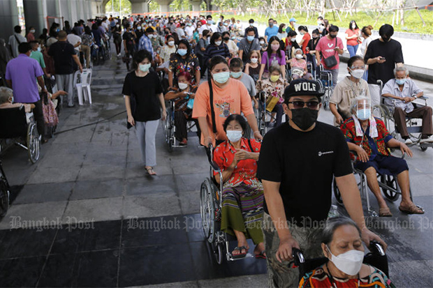 Elderly people queue in wheelchairs for vaccination at Bang Sue Grand Station on Saturday. (Photo: Wichan Charoenkiatpakul)