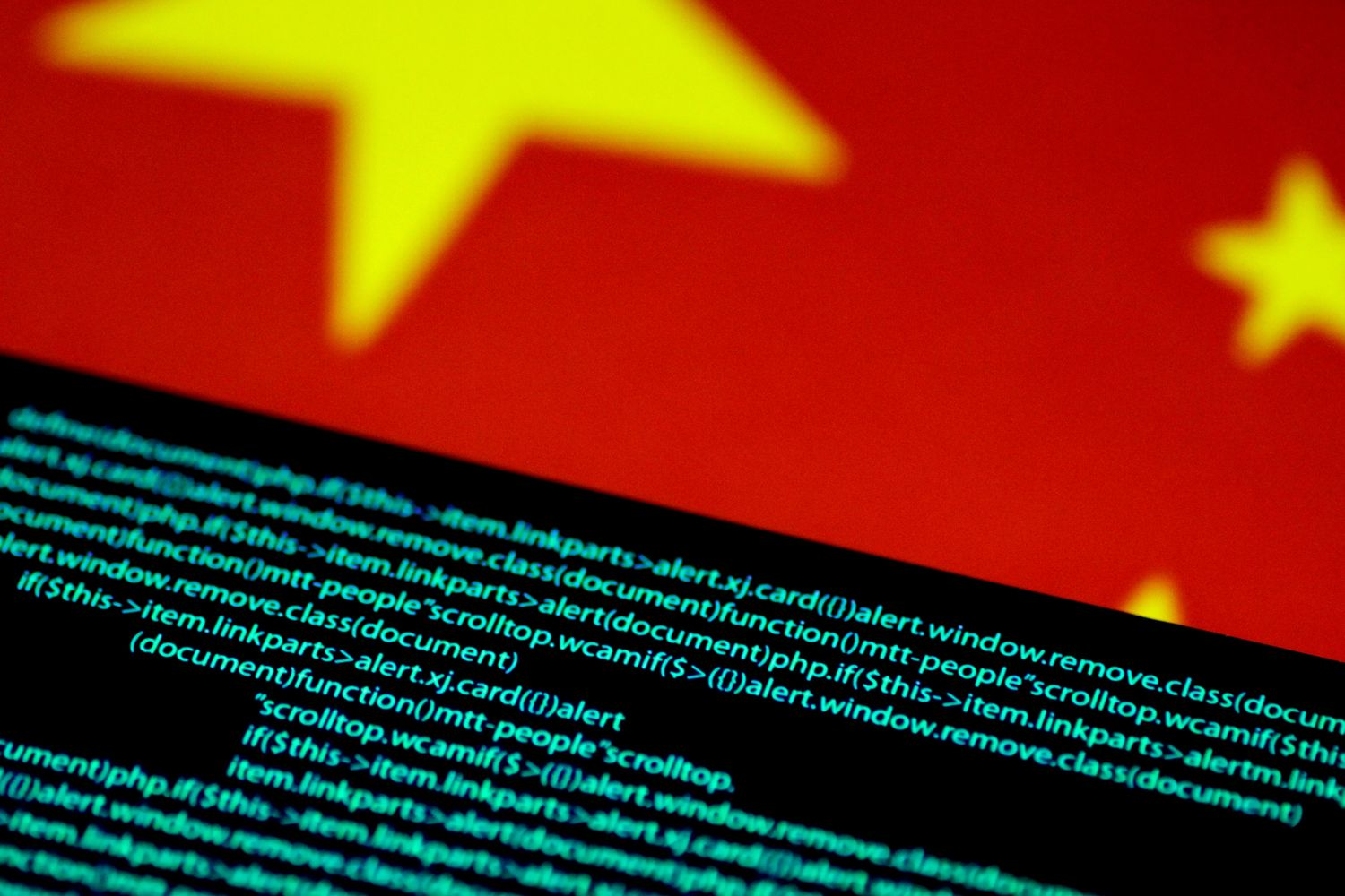 Computer code is seen on a screen above a Chinese flag in this July 12, 2017 illustration photo. (Reuters photo)