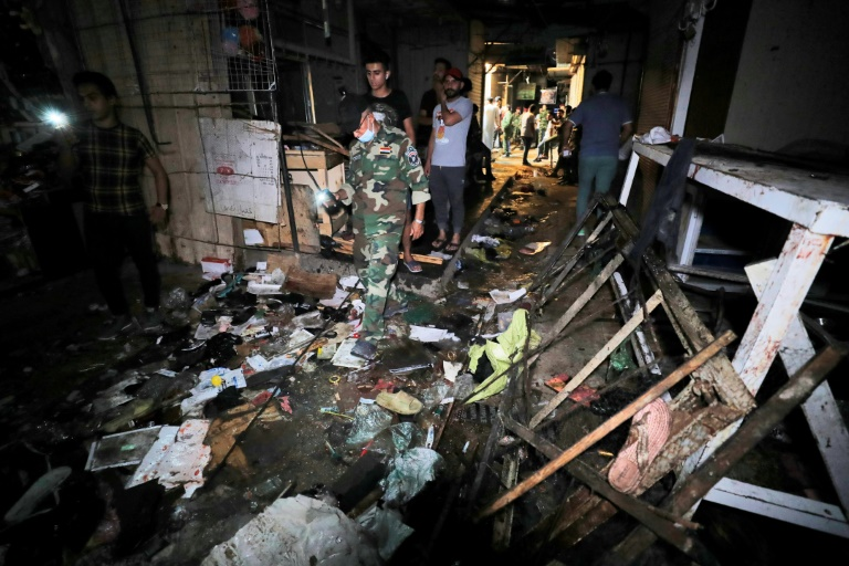 Iraqis inspect the site of the explosion in a popular market in the mostly Shiite neighbourhood of Sadr City.