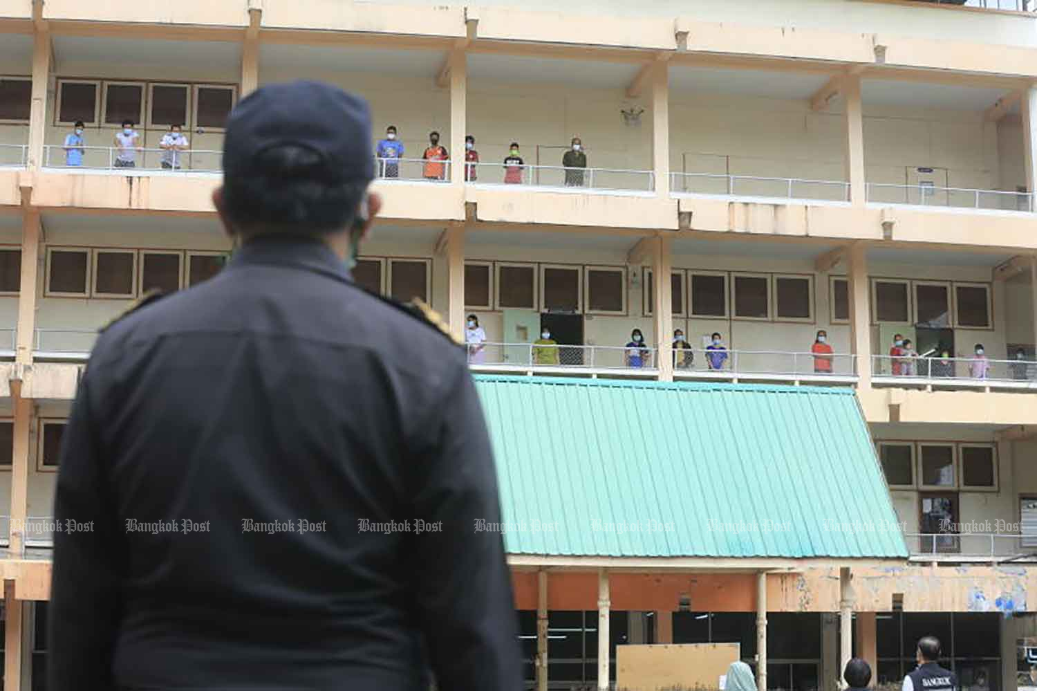 A city inspector surveys the Chao Phraya Commercial Technological College in Bangkok's Ratchathewi district on Tuesday. The college has been turned into a community isolation centre for Covid-19 patients. (Photo: Pornprom Satrabhaya)