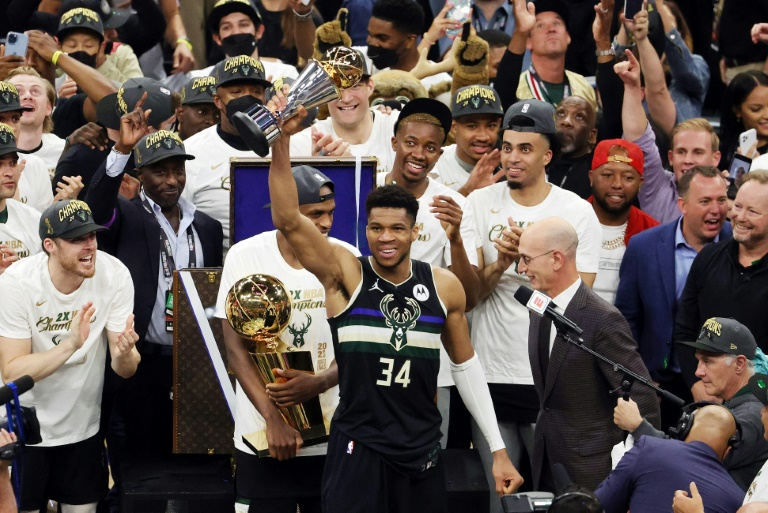 Giannis Antetokounmpo scored 50 points to power the Milwaukee Bucks over Phoenix on Tuesday to claim their first NBA title since 1971 and win NBA Finals Most Valuable Player honors