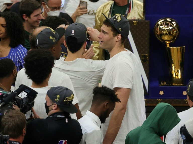 Milwaukee Bucks center Brook Lopez celebrates on the court after the club captured its first NBA title in 50 years by beating the Phoenix Suns on Tuesday