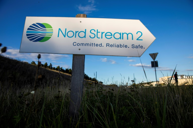 A road sign directs traffic towards the Nord Stream 2 gas line landfall facility entrance in Lubmin, north eastern Germany, in 2020.