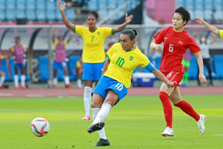Landmark goal: Brazil's Marta scores the opening goal against China in in Miyagi.