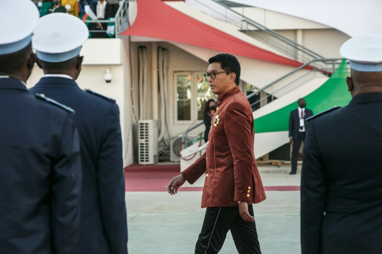 Rajoelina inspects the troops on Madagascar's Independence Day last month.