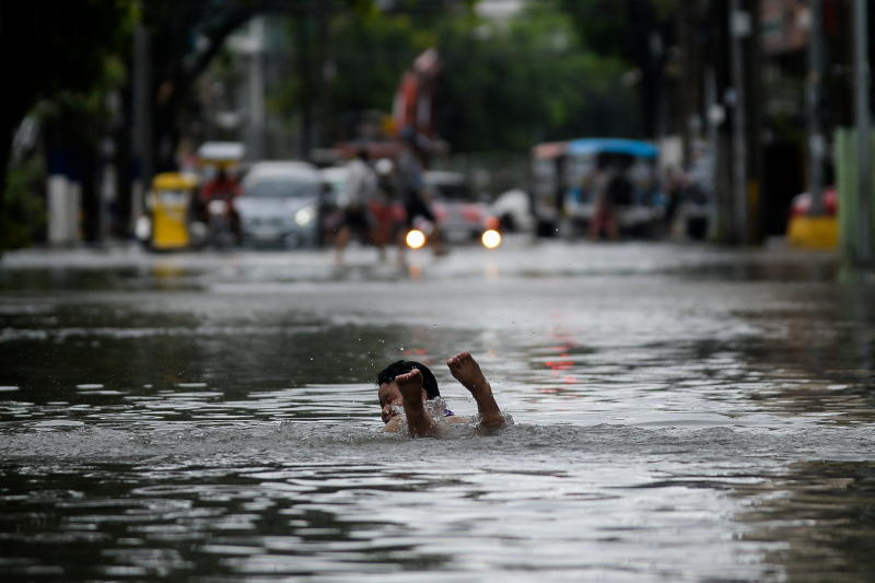 Monsoon rains flood Philippines as thousands evacuated