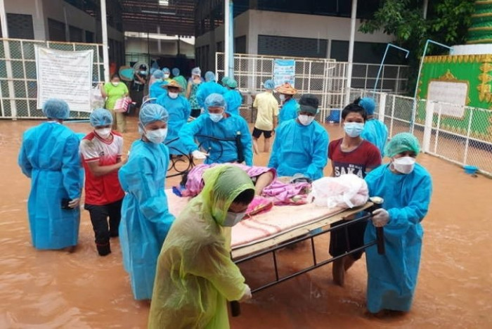 Myanmar floods, coup, complicate growing Covid-19 outbreak