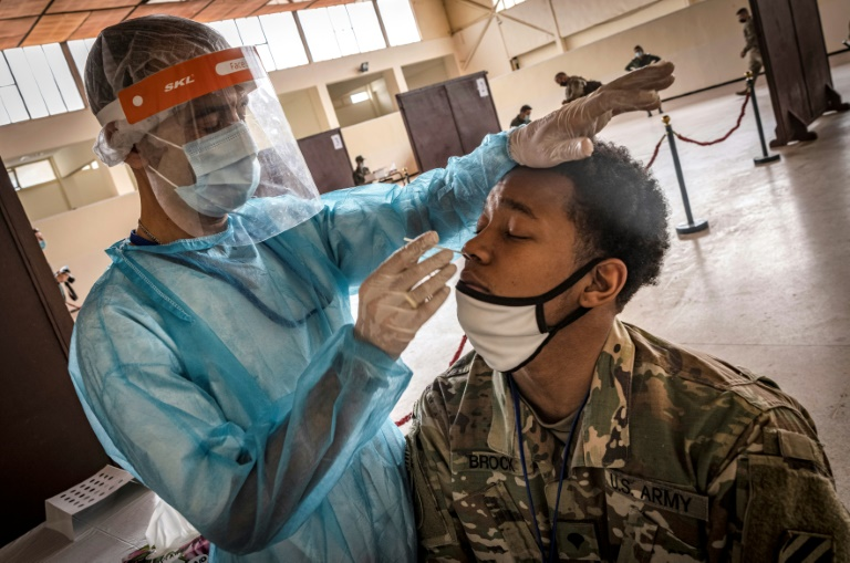 A US army soldier is tested for Covid-19 upon arrival at Morocco's Agadir military airport in June 2021 amid ongoing restrictions on travel due to the pandemic.