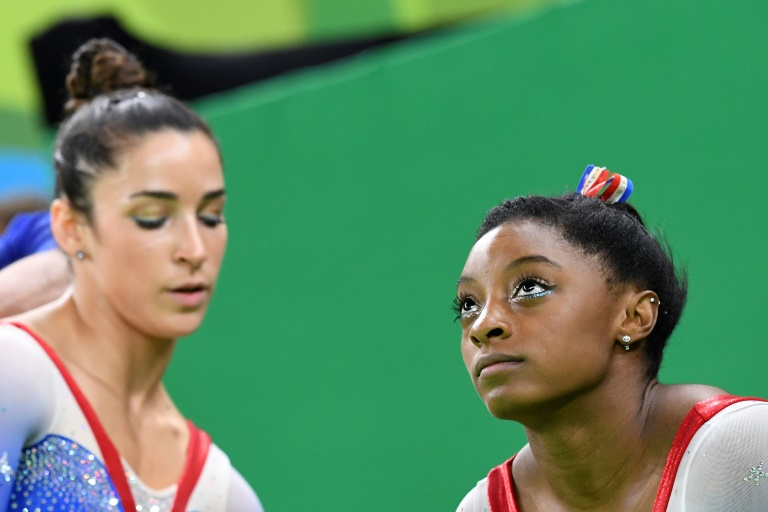 Biles supported by US gymnasts, other athletes, celebs