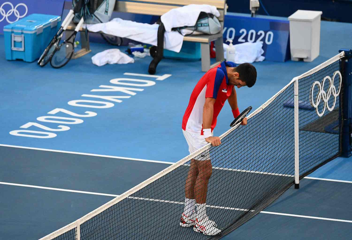 Novak Djokovic reacts after losing to Spain's Pablo Carreno Busta their men's singles tennis match for the bronze medal at the Ariake Tennis Park in Tokyo on Saturday. (AFP Photo)