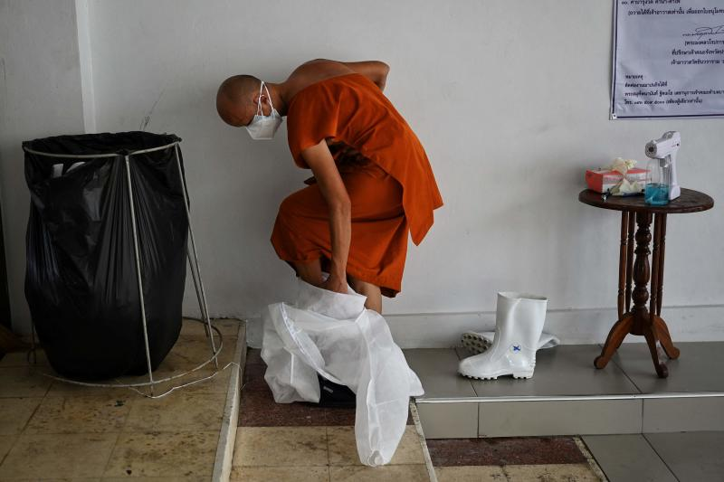 Monks don protective gear as Covid cases surge