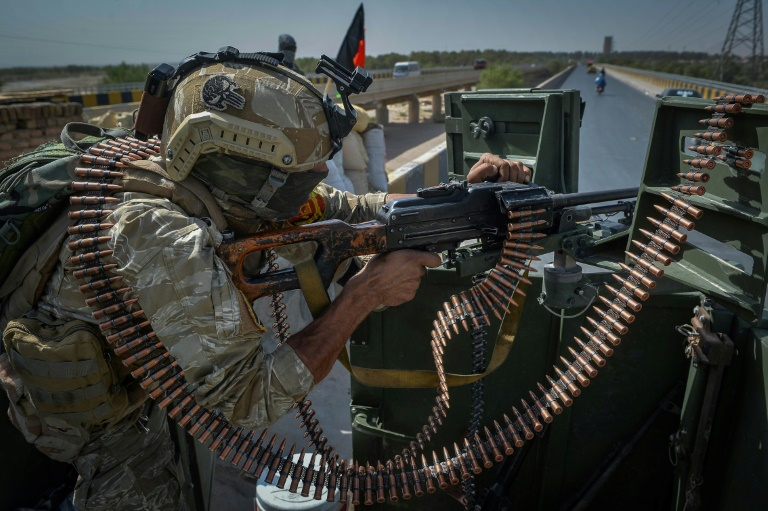 An Afghan soldier keeps guard outside the United Nations Assistance Mission in Afghanistan compound in Herat a day after the mission was attacked