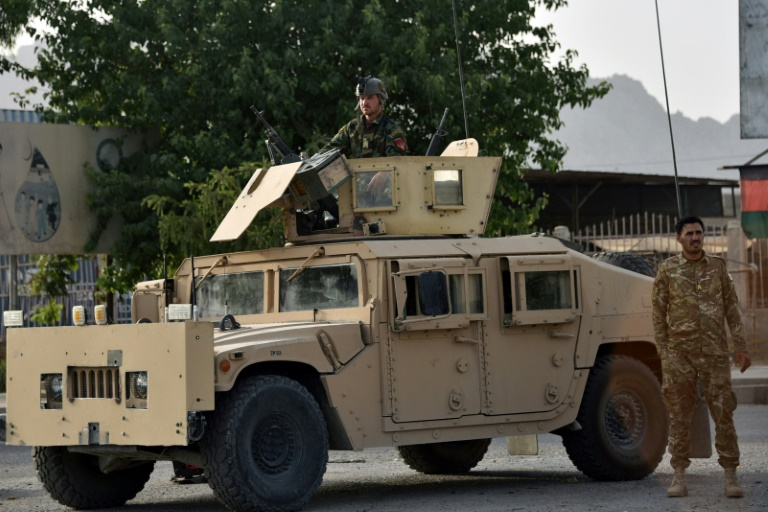 Afghan forces battle to thwart Taliban assaults on key cities