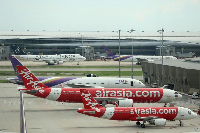 Thai AirAsia jets are seen at Don Mueang airport. (Bangkok Post file photo)