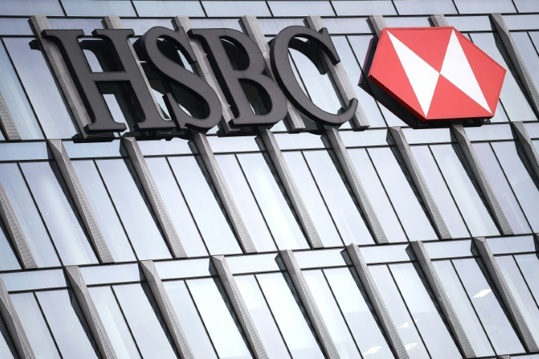 HSBC first-half profits more than double, resumes dividends
