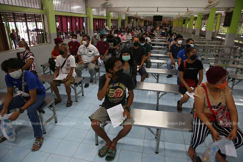 People wait their turn for a vaccine jab at the Keha Choomchon Lat Krabang School in Bangkok on Wednesday. (Photo: Varuth Hirunyatheb)