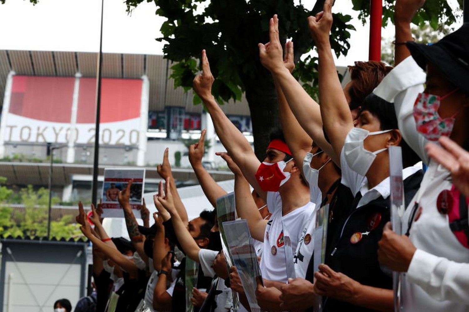Protesters show three-finger salutes during a rally of Myanmar protesters residing in Japan, outside the National Stadium, the main venue of the Tokyo 2020 Olympic Games, on July 26 (Photo: Reuters)