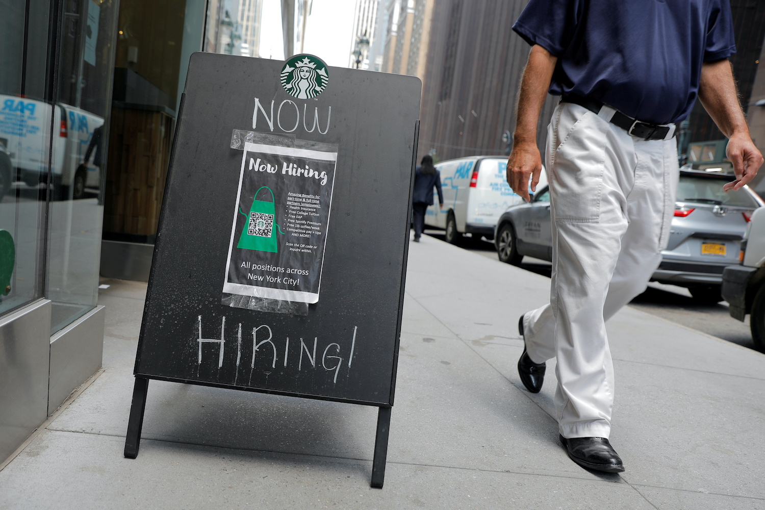 A sign advertising job openings is seen outside of a Starbucks in New York City in late May. (Reuters Photo)