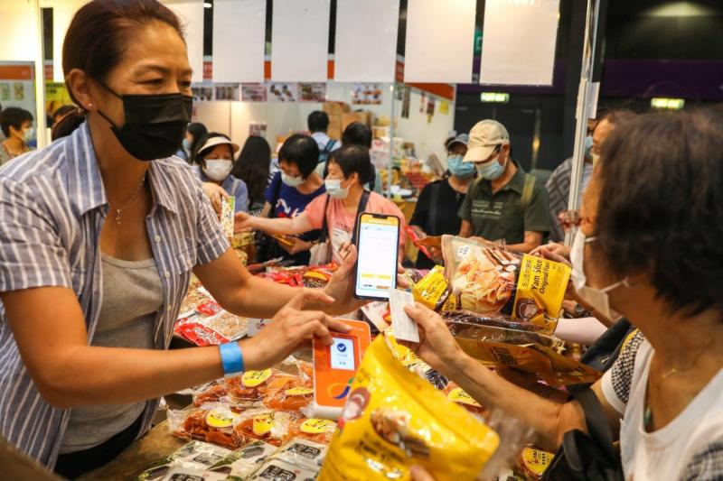 Numerous visitors to Saturday's HK Bands and Products Shopping Expo were spotted making purchases with their e-vouchers. (South China Morning Post photo)