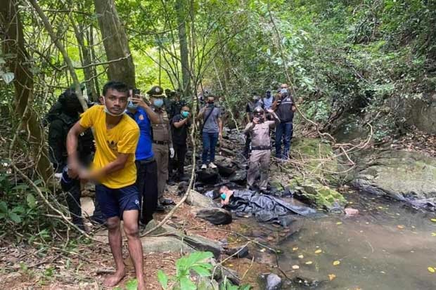 Police take suspect Teerawat Thothip to Ton Ao Yon waterfall in Phuket where he allegedly killed a Swiss tourist. It was part of a crime re-enactment on Sunday. (Photo: Achadtaya Chuenniran)