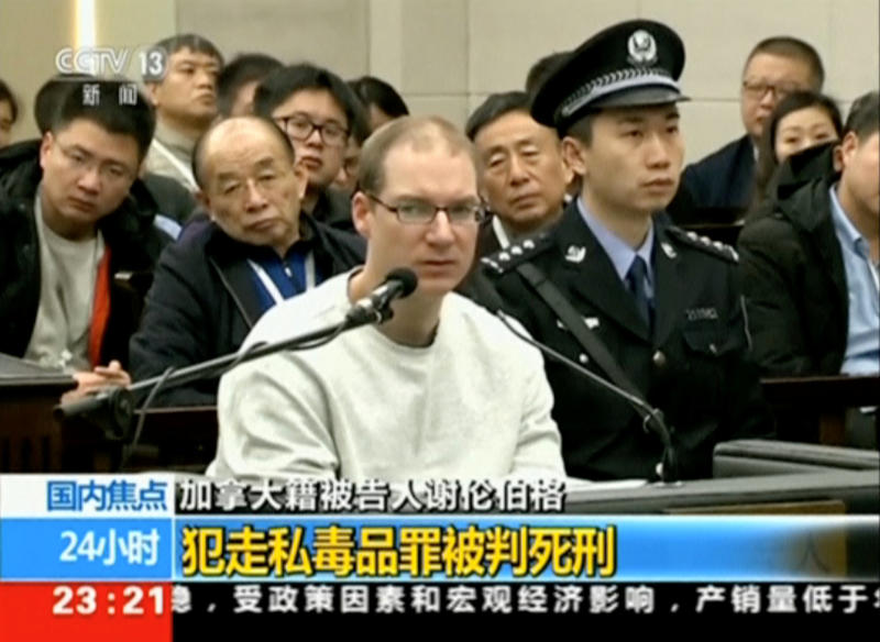 FILE PHOTO: A still image taken from CCTV video shows Canadian Robert Lloyd Schellenberg in court, where he was sentenced to death for drug smuggling, in Dalian, Liaoning province, China Jan 14, 2019. (CCTV/Reuters TV)