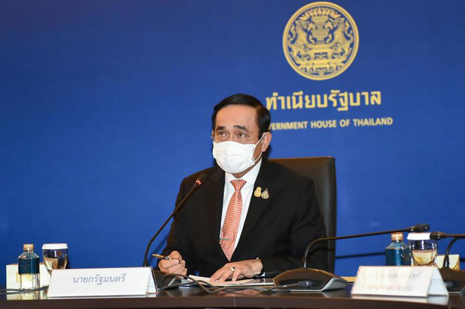 Prime Minister Prayut Chan-o-cha chairs a meeting with representatives of the Thai Chamber of Commerce and company executives tackle the Covid-19 pandemic at Government House on July 21 via video conference. (Government House photo)