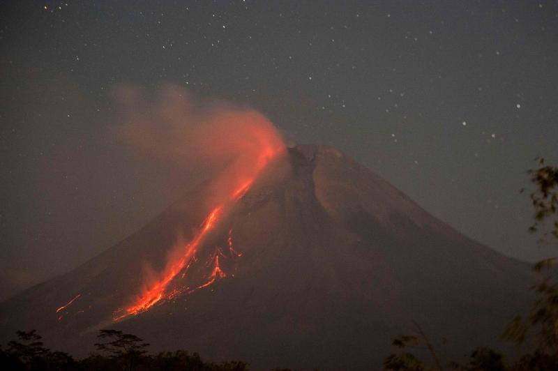 Mount Merapi, Indonesia's most active volcano, spews ash and lava from its peak as seen from Sleman in Yogyakarta on Monday. (AFP photo)