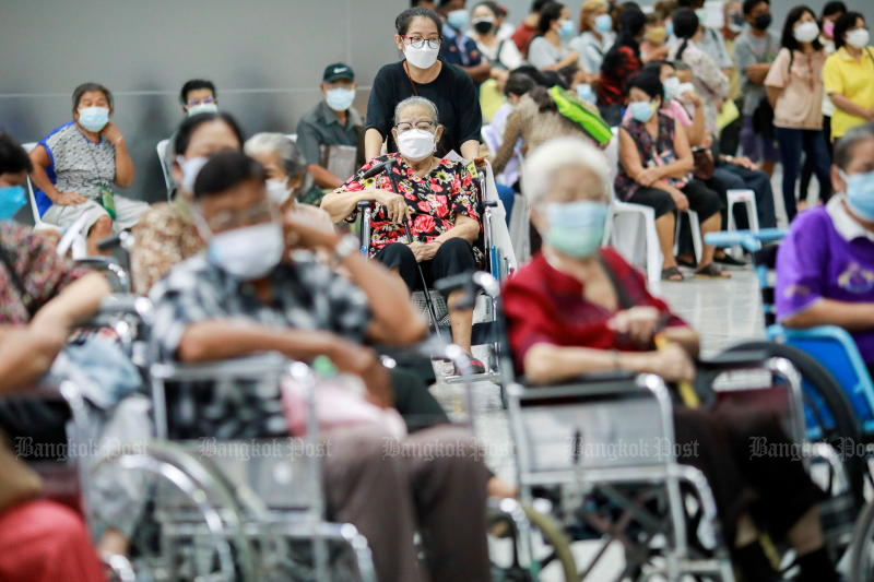 FILE PHOTO: People queue at the Central Vaccination Center on July 26, 2021 as Thailand opens walk-in for the first dose of the AstraZeneca vaccination scheme for elders, people with a minimum weight of 100kg and pregnant women, amid the coronavirus outbreak in Bangkok. (Reuters)