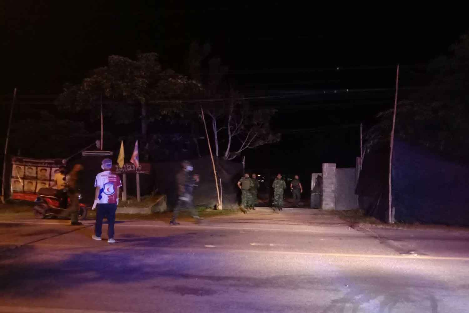 Soldiers at the entrance to the military base at Ban Khuan in tambon Phron of Yala's Muang district after a pipe bomb was thrown into the grounds on Monday night. One soldier was wounded by the explosion. (Photo: Abdullah Benjakat)