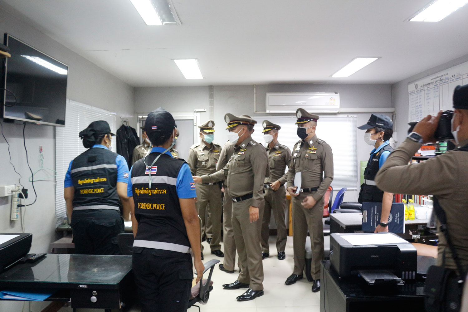 Police examine the interrogation room at Muang police station in Nakhon Sawan province where seven officers allegedly tortured a drug suspect to death, suffocating him with a plastic bag. (Photo: Chalit Phumruang)