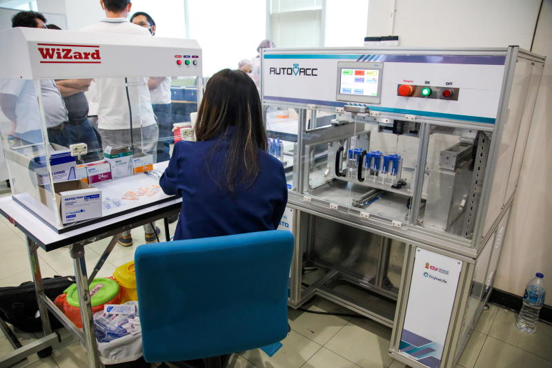 A technician works at the AutoVacc vaccine extraction machine designed by the Chulalongkorn University's Biomedical Engineering Research Center to extract extra doses out of AstraZeneca vaccine vials in Bangkok on Monday. (Reuters photos)