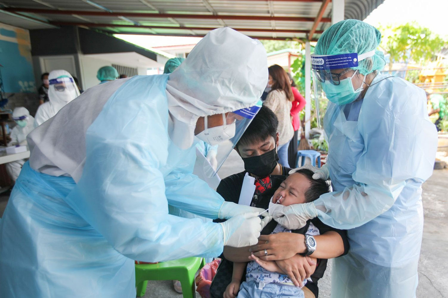 A boy reacts as a health worker takes a nasal swap with antigen test kit at a Covid-19 testing venue in Pattaya, Chon Buri, on Wednesday. The Pattaya City municipality tested 530 people at seven communities on Wednesday, and 29 were positive. (Photo:@Prpattayacity Facebook page)