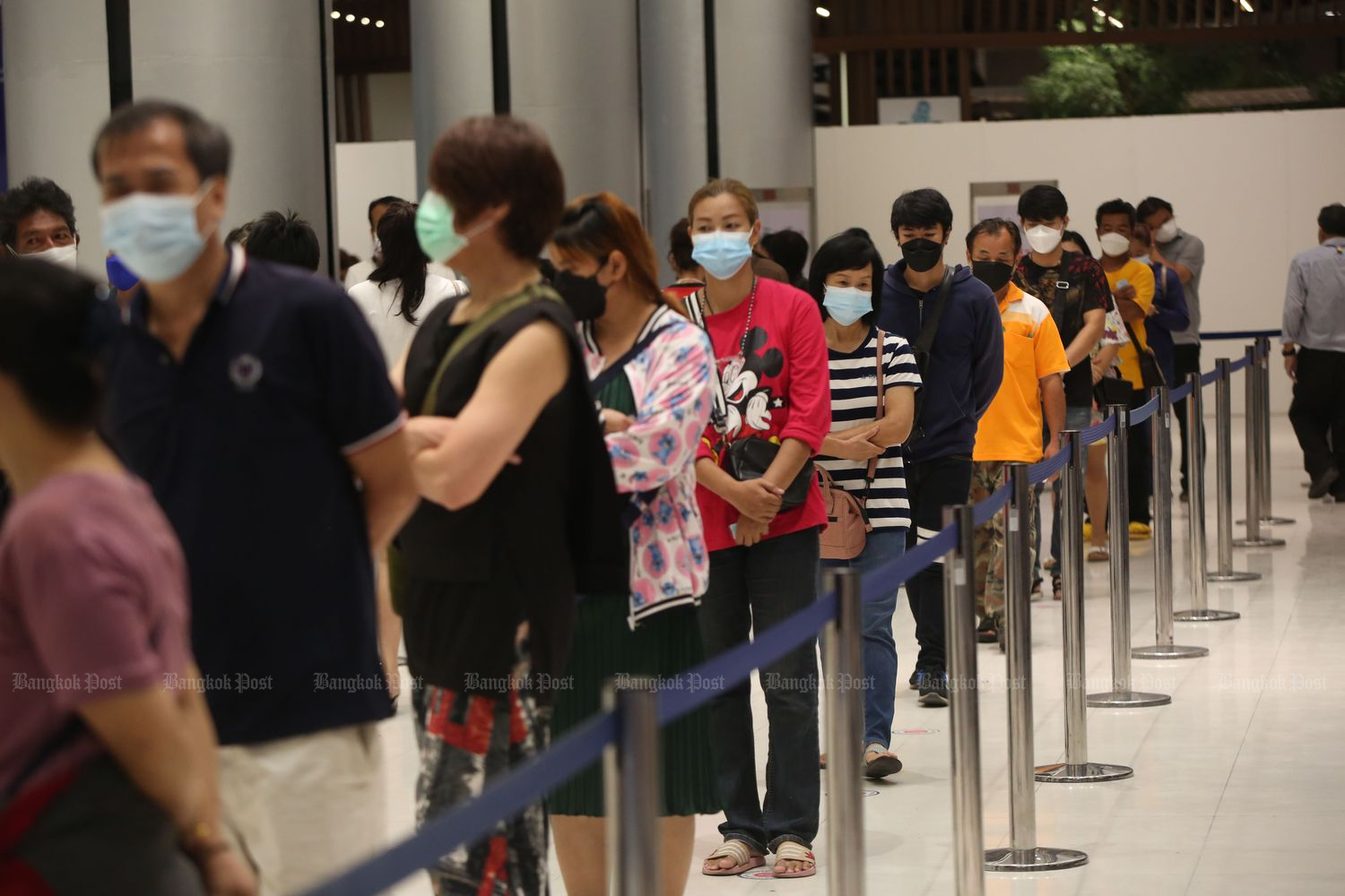 People wait in line to be vaccinated at The Mall Gang Kapi in Bangkok on Thursday. (Photo by Varuth Hirunyatheb)