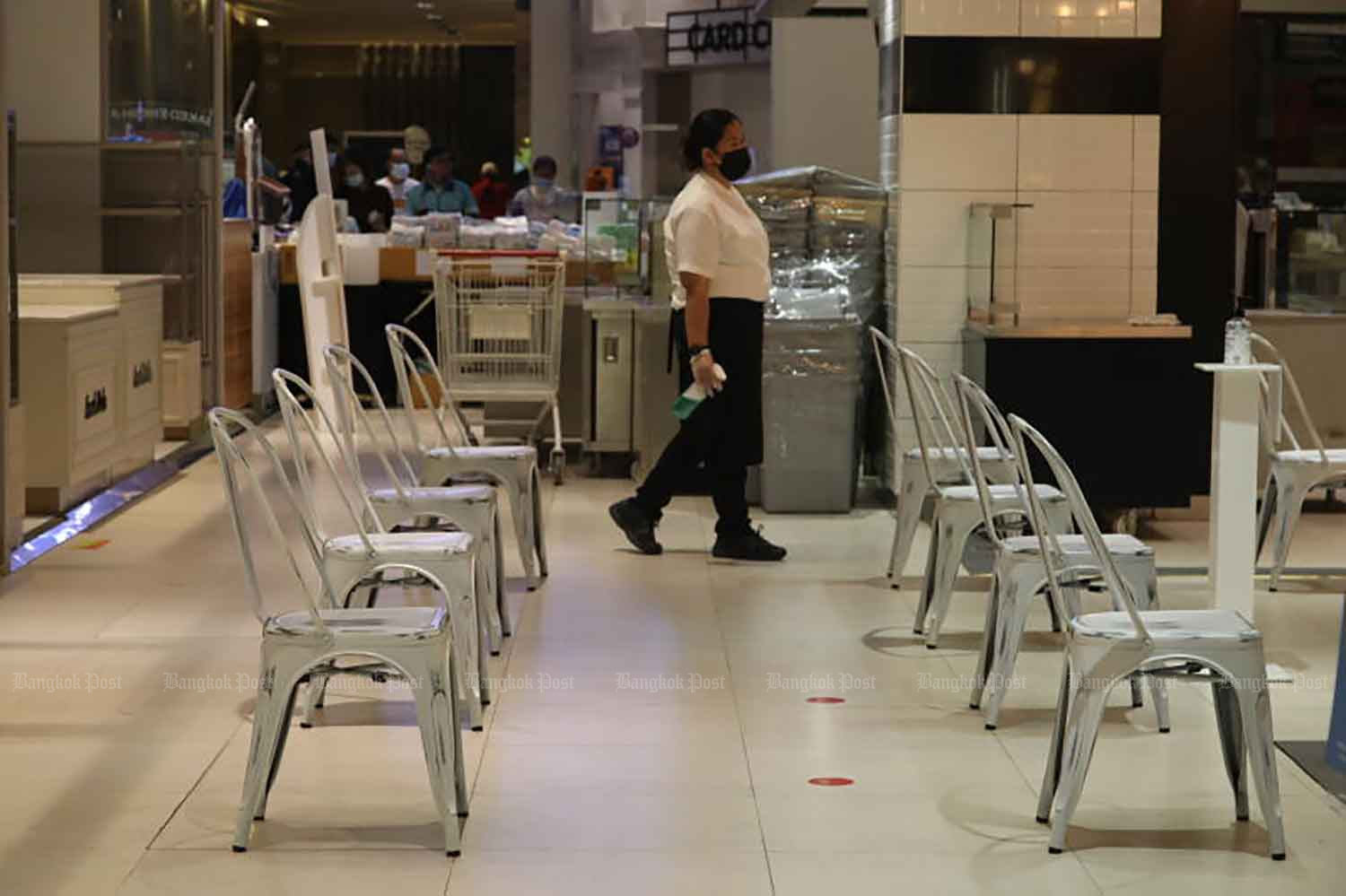 Chairs arranged for customers waiting for takeaways at a shopping centre food court in Bangkok. From Sept 1, the government will allow eateries to reopen for dining-in with strict Covid-19 controls. (Photo: Arnun Chonmahatrakool)