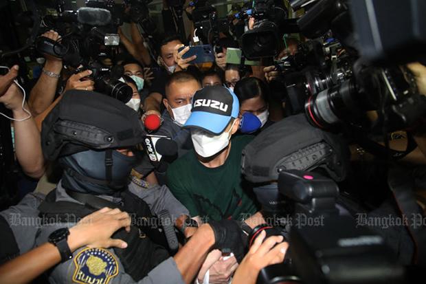 Pol Col Thitisan Utthanaphon is taken from the Crime Suppression Division in Bangkok to Nakhon Sawan on Thursday night. (Photo: Arnun Chonmahatrakool)