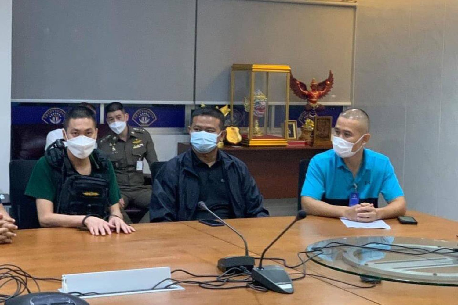 Pol Col Thitisant Utthanaphon (left), former chief of the Muang Nakhon Sawan police station, is questioned by senior police at the Crime Suppression Division in Bangkok on Thursday. (Crime Suppression Police photo)