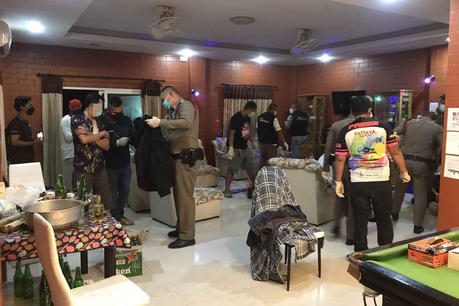 Police raid the birthday party house in Chon Buri's Bang Lamung district on Tuesday night and arrest 18 people. (Photo: Chaiyot Pupattanapong)