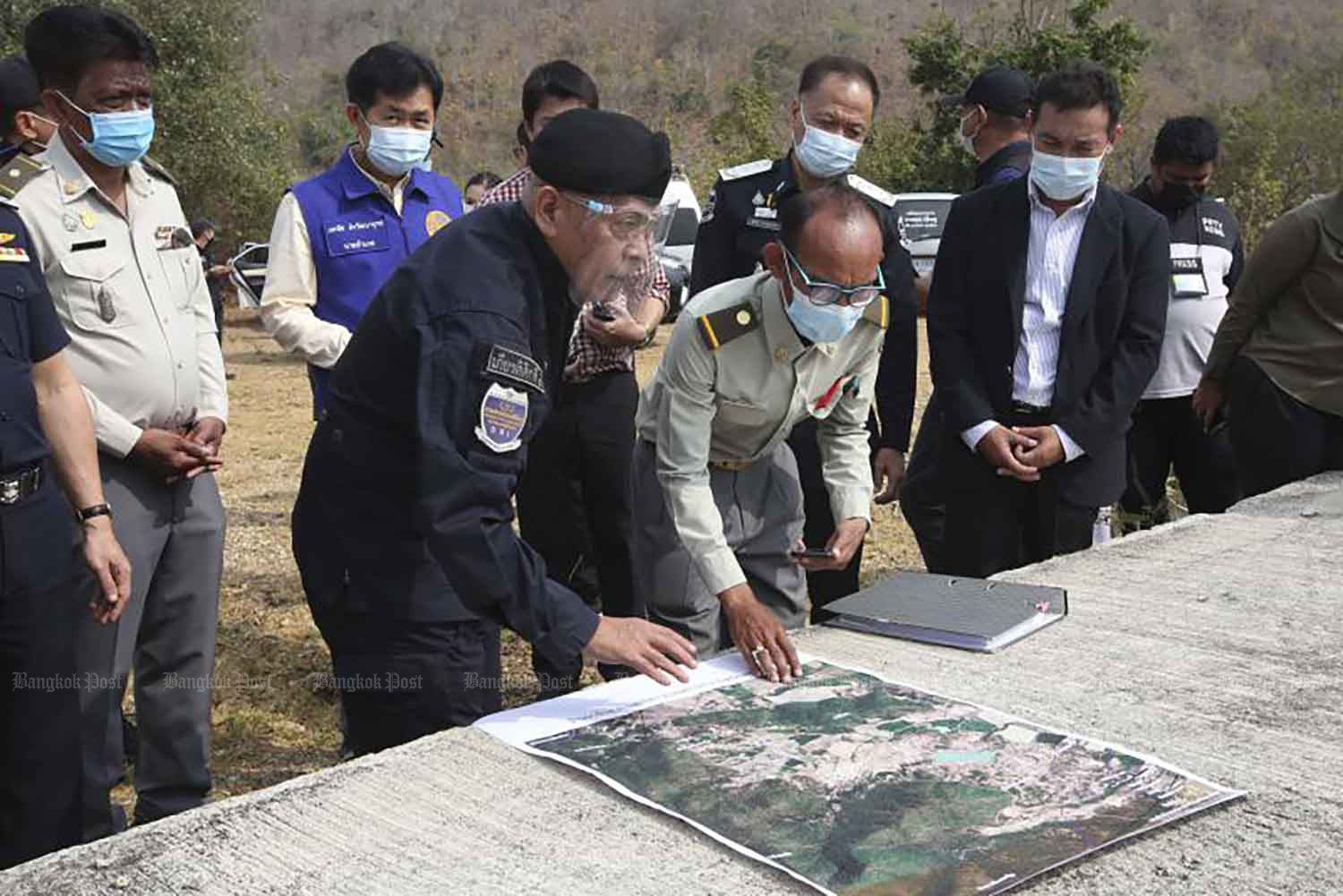 DSI director-general Korawat Panprapakorn, centre, inspects the site supposedly to be used for the Phetchaburi Park project in Phetchaburi province, in February. (Photo: Pattarapong Chatpattarasill)