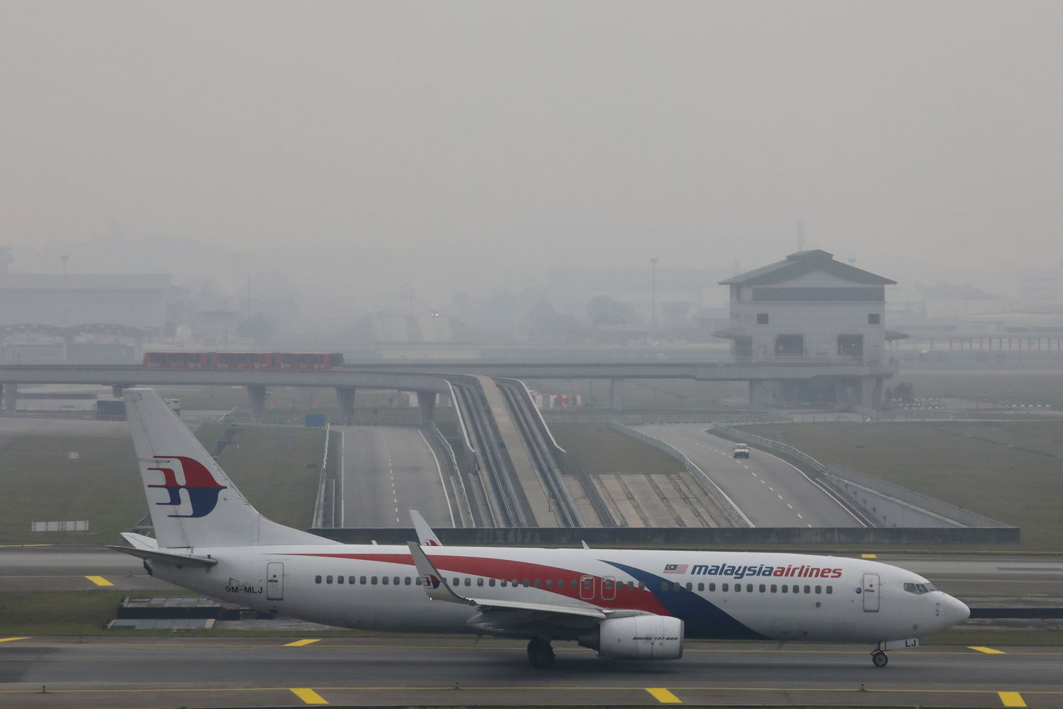 A Malaysia Airlines Boeing 737-800 aeroplane is pictured on the haze-shrouded tarmac at Kuala Lumpur International Airport in Sepang, Malaysia, in 2019. (Reuters photo)