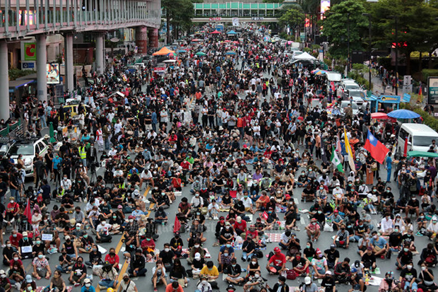 Protesters occupy the Ratchaprasong area in central Bangkok on Friday, demanding the resignation of Prime Minister Prayut Chan-o-cha. (Photo by Chanat Katanyu)